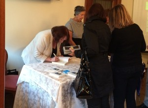 Val Culley signs copies of Death in the High City
